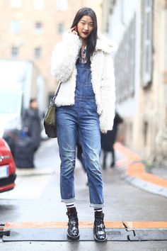 She committed to the '90s feel with overalls, combat boots, and a burgundy lip. Milan Fashion Week Fall 2014 Street Style