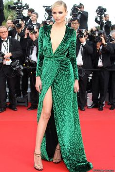 Supermodel Natasha Poly looks like a ferocious fashion animal in this velvet, emerald dress with dangerous splits. Sleek side parting and dark kohl eyes finish the look.