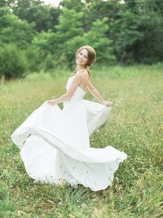 Bride twirling in dress, Styled shoot by Mallory Joyce and Rachel May Photography