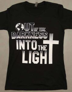 Front of shirt Christian T-shirt Inspired by Bible Scripture   1 John 1:7 – But if we walk in the light as He is in the light, we have fellowship with one another, and the blood of Jesus Christ His Son cleanses us from all sin.  Let everyone know you have chosen the LIGHT of Jesus Christ over the DARKNESS of this world. Where there is light the darkness cannot exist!  White Print on black tshirt , white CNTW(CoverednTheWORD) & 1 John 1:7 print on back of shirt.