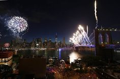 Fireworks explode over the East River with the Manhattan skyline and Brooklyn bridge in the background as part of the 38th Annual Macy's Fourth of July fireworks in Brooklyn, New York, July 4, 2014