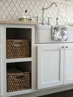 Use bins and baskets: http://www.stylemepretty.com/living/2014/05/01/18-kitchen-organization-tips-tricks/