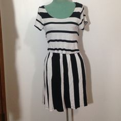 H&M Striped Dress Cute and comfy striped dress with a cut out on the back. Looks awesome with a solid color chunky scarf and boots! :) in good condition H&M Dresses
