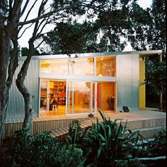 """This """"bach"""" is perched on a sand dune on New Zealand's Kapiti Coast. A bach is a modest vacation home in New Zealand, originally referring to a basic shack built from inexpensive or recycled materi..."""