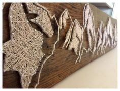 This String Art is hand crafted. When this item is Out of Stock -Please allow at least 7 business days for this work of art to be created.  Measurements : 53.5 in Length 9.25 in Height About 2 in Depth  This is a thick cut of wood and is Heavy, (NOT PLYWOOD-Thin) This piece does come with Hardware already installed on the back and ready to hang! Please be aware of the weight while attempting to hang this art work. You will need proper support on a drywall/studs to support the weight of this…