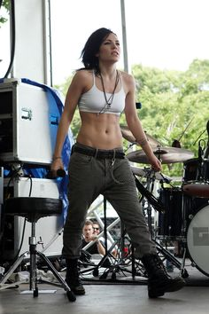 Skylar Grey showed off her rock-solid abs in cargo pants, a cropped tank, and tough boots.