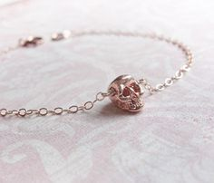 love this !Tiny Rose Gold Skull Bracelet