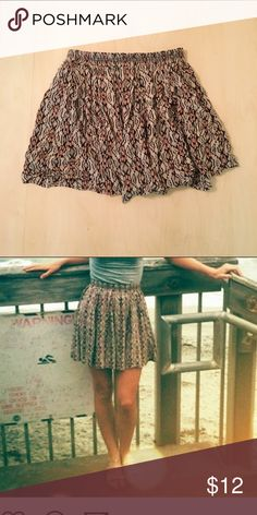Tribal print skirt Tribal print skater skirt from Brandy Melville. It is tan, muted pink, and black. Very cute and comfortable to wear! Brandy Melville Skirts Mini