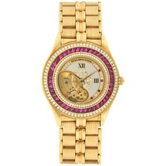 Mauboussin Lady's Yellow Gold, Ruby and Diamond Wristwatch | From a unique collection of vintage wrist watches at http://www.1stdibs.com/jewelry/watches/wrist-watches/