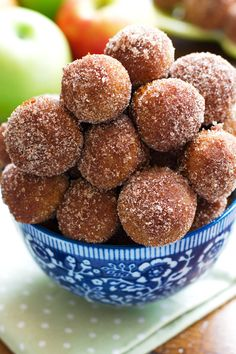 Baked apple cider donut holes are easy to make and are made with no oil and are not fried! These donut holes are baked then rolled in cinnamon sugar! | littlespicejar.com #donuts #applecider #fallrecipes