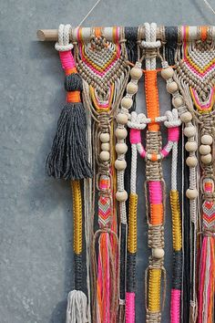 MIZI Unique wall hanging macrame with tassels & pompoms on light timber dowel high contrast & bright colours with raw timber beads combines natural tones with bright colours and has beautiful details size: approx. 400 x 1100 mm (wall hanging itself, without the dowel) colours : jute, mustard yellow, neon orange, neon pink, few tones of beige, dark gray wall hangings are an amazing home decor they immediately transform your room I love the atmosphere they create! Free shipping w...