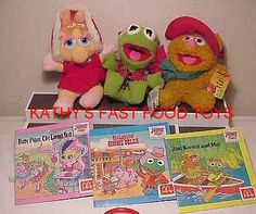 """So somewhere in between the Happy Meal toys and the cartoon, were these limited edition """"holiday"""" plushies, and yours truly managed to snag both Piggy and Kermit (because they go together, naturally).  I can't remember if I had FOzzie or not (making a rather awkward """"third wheel"""" to the set)."""