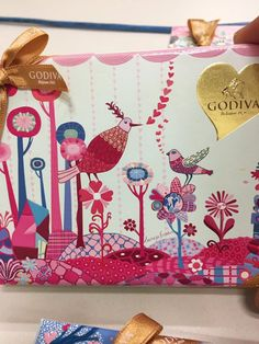 We're so thrilled to see our artist Sarajo Frieden on Godiva's homepage!  She had the opportunity of a lifetime working on this very special edition for Godiva's 2017 Valentine's Day Collection. Images from Godiva website. The packaging is stunning and captures the playful wit and colorful palette of Sarajo's work. As part of this project, …