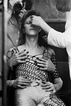 Bowie being made up before filming of 'The 1980 Floor Show' at the Marquee Club London He is wearing a cobweb costume.