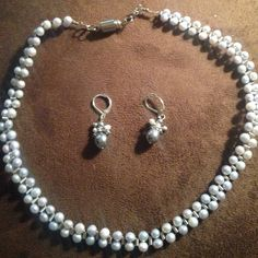 Costume pearl necklace with earrings Grey pearls with silver accents. Necklace with earrings, very light weight. Jewelry