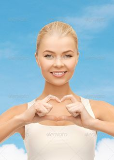 smiling woman showing heart shape gesture ...  amour, attack, beat, blue, cardiac, cardiology, care, casual, chest, clinic, cloud, disease, feelings, female, gesture, girl, hands, happiness, harmony, health, healthcare, heart, help, human, humanity, ill, illness, life, love, medicine, peace, people, person, relationship, risk, romantic, shape, share, show, sick, sickness, sign, sky, support, symbol, treatment, valentine, white, woman, young