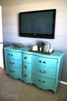 Guest Bedroom #1 - This is like the dresser I am refinishing for the main guest bedroom.  Love the giant seashell  decorations and I love the simplicity of the mounted tv.