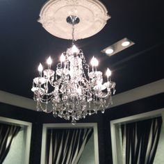 I think dark ceilings work especially well with the drop edge chandelier with contrasting dark ceiling and white molding amazing statement mozeypictures Image collections