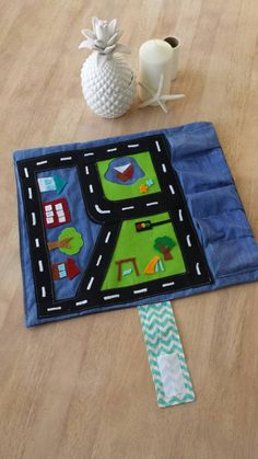 Items similar to Car 'Play & Go' Roll Up Play Mat! Boy's /Kids Matchbox and Hotwheels Travel Tote with town scene Garages. Made to order. on Etsy Car Play Mats, Car Mats, Sewing Toys, Sewing Crafts, Sewing Projects, Sewing For Kids, Diy For Kids, Travel Toys, Operation Christmas Child