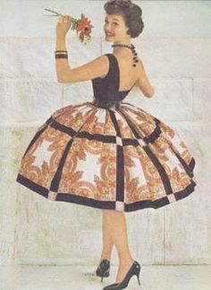 1950s - wow. I love it that I have a skirt that's very similar to that. Now I need a low-backed top like this one.