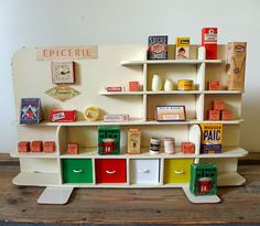 This french toy grocery shop would be the perfect dramatic play center for kids.