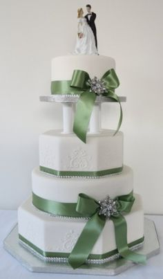 Alternating octagonal and round four tier cake with ribbons, traditional bride and groom and a touch a sparkle  Art 'n Icing Wedding Cake, Wellington