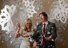 huge paper snowflakes as a backdrop.