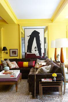 modern artwork, lacquered walls, cheetah carper, velvet sectional, ikat pillow, global mix, mirrored wall, nick olsen