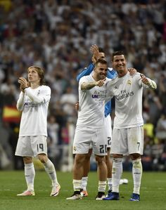 Real Madrid's Croatian midfielder Luka Modric, Real Madrid's forward Jese Rodriguez and Real Madrid's Portuguese forward Cristiano Ronaldo celebrate their victory at the end of the UEFA Champions League semi-final second leg football match Real Madrid CF vs Manchester City FC at the Santiago Bernabeu stadium in Madrid, on May 4, 2016.