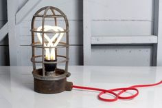 Seven ways to style industrial cage pendant lights … and where to get them!