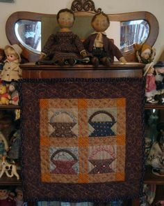 by Mary K. Love the quilt and the dolls she made