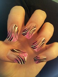 Sparkle pink tips, with white and black free hand art design on gel nails.