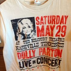 graphic Dolly Parton concert t Worn once. Cream colored tee with black and red print. Commemorates past Nashville Concert. Looks great with jeans and a black blazer! Urban Outfitters Tops Tees - Short Sleeve