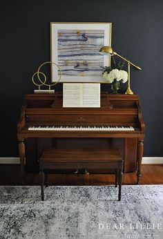 More Progress In Our Living Room - Dear Lillie Studio Adding some modern touches like this gold scupture and reading lamp from HomeGoods helps too balance out the traditional feel of the piano and give it an updated look. Piano Living Rooms, Formal Living Rooms, Home Living Room, Living Room Designs, Living Room Decor, Piano Vertical, Piano Room Decor, Piano Lamps, Desk Lamp
