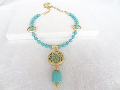 He encontrado este interesante anuncio de Etsy en https://www.etsy.com/es/listing/170759401/turquoise-gold-necklace-neclace-in