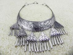 """Spirits of the Forest Hmong tribal silver by CultureCross on Etsy  """"This is a traditional Miao Hmong hill tribe style. Traditionally worn for good luck and protection.  Etched designs including an elephant, an animal believed by the Miao Hmong to bring good luck and prosperity. Made with high-quality jewelry brass and silver."""""""