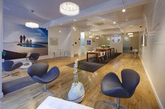 Nu Skin 'Spark Centre' by Green Room, London. The design uses a pure palette of materials including wood, glass and stainless steel, along with a variety of furnishings and integrated AV equipment to provide a welcoming, professional and positive Nu Skin brand experience.