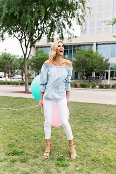 This summer is all about the off the shoulder trend. Naturally, I had to try it for myself but opted for a chambray style. Click through for more on this trendy summer outfit! | white jeans outfit | white denim outfit | chambray top outfit | chambray shirt outfit | NYC blogger | spring outfit idea | chambray off the shoulder top | off the shoulder top outfit | OTS top outfit