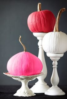 pink and white pumpkins on white pedestals, fall decor