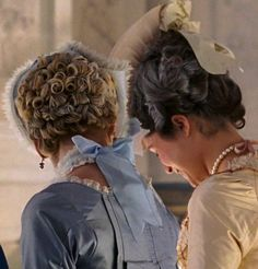 Kirsten Dunst as Marie Antoinette and Mary Nighy as the Princesse de Lamballe in Marie Antoinette (2006).