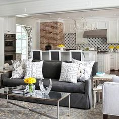 living rooms - charcoal gray sofa,  fretwork pillows, white and silver pillows. too much white but like sofa color and pillow patterns