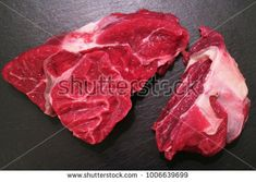 Cut of French chuck beef steak part on a black chopping board