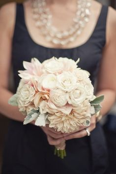 The maid of honor will carry a small clutch bouquet of Café au lait dahlias, ivory garden roses, ivory spray roses, and dusty miller wrapped in ivory satin ribbon with the stems showing
