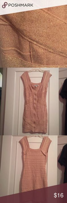 Pink bondage dress with gold shimmer Beautiful and sexy pale pink bandage dress with gold shimmer. Perfect for a night out on the town! In great condition, worn only once. Forever 21 Dresses Mini