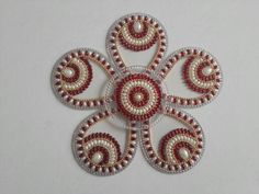 Kundan rangoli by Smita.