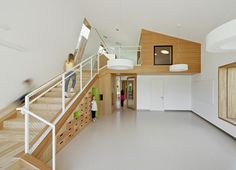 Kindergarten Terenten by Feld72 - shallow stairs with storage underneath, mezzanines and windows connecting spaces.