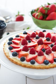Yum! If you've got a sweet tooth, then this refreshing berry tart with lemon cookie crust recipe is just for you! It's fast, easy and simple. This treat is so delicious, one slice won't be enough.