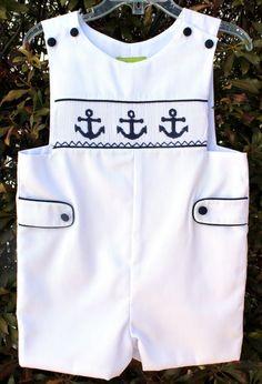 White w/navy piping and navy  smocked anchors. Shortall/Jon-Jon with smocked insert.