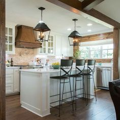 want those kitchen light fixtures and exposed wood beams