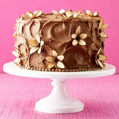 holy crap! i would have never thought to use almonds as flower petals on a cake!